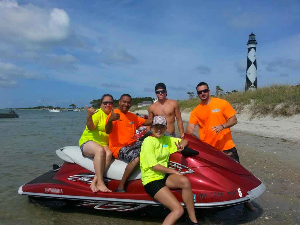 family at island on jet skis